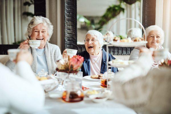 Shot of happy senior women having tea together at a retirement home