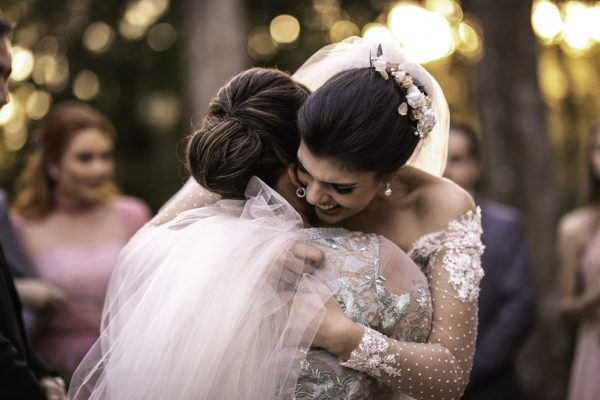 Emotional bride being congratulated by the wedding guests
