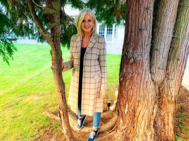 In Helene Berman coat